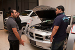 An Iraqi salesmen shows customers the latest models of imported American cars at a recently opened Dodge/Jeep/Chrysler dealership in the Karrada district of Baghdad August 23, 2010. Iraqis have developed a healthy appetite for newly available consumer goods including cars, satellite dishes and cel phones over the past several years.  .