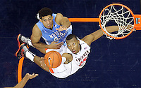 Virginia forward Akil Mitchell (25) grabs a rebound in front of North Carolina forward James Michael McAdoo (43) during the game at the John Paul Jones arena in Charlottesville, Va. Virginia defeated North Carolina 61-52.