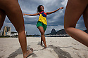 Young Brazilian women have fun at the beach in Rio de Janeiro, Brazil.