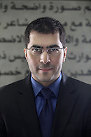Newsreader for Al Jazeera English Sami Zeidan, in front of the channel's code of ethics in the foyer of their main building in Doha.