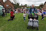 Father pushing pram. May Day Fair Glam Rock Band The Look the Perch and Pike pub South Stoke Berkshire UK 2006