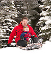 California, Lake Tahoe: Child and father enjoy snow play with sled at North Lake Tahoe Regional Park.  Photo copyright Lee Foster.  Photo # cataho107506