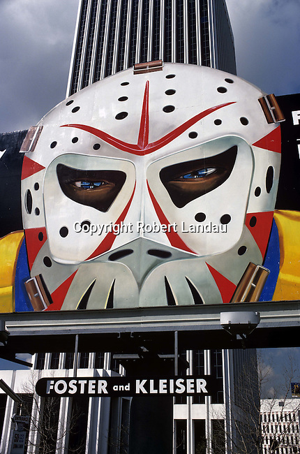 Hockey goalie with mask on billboard for Los Angeles Kings Ice Hockey advertisement
