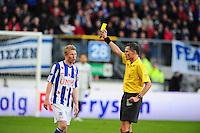 VOETBAL: HEERENVEEN: Abe Lenstra Stadion, SC Heerenveen - Vitesse, 21-01-2012, Eindstand 1-1, scheidsrechter Tom van Sichem geeft een gele kaart aan Doke Schmidt (#36), ©foto Martin de Jong
