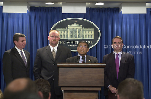 United States Attorney General John Ashcroft, FEMA Administrator Joe Allbaugh, Transportation Secretary Norman Mineta, and HHS Secretary Tommy Thompson make statements  in the White House Briefing Room in Washington, D.C. on Tuesday, September 11, 2001 in the hours following the terrorist attacks against the World Trade Center in New York and the Pentagon in Washington, DC..Credit: Ron Sachs / CNP