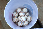 02 June 2016: A bucket of official tournament baseballs. The Nova Southeastern University Sharks played the Cal Poly Pomona Broncos in Game 11 of the 2016 NCAA Division II College World Series  at Coleman Field at the USA Baseball National Training Complex in Cary, North Carolina. Nova Southeastern won the semifinal game 4-1 and advanced to the championship series.