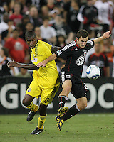 Stephen King #20 of D.C. United shields the ball from Andy Iro #6 of the Columbus Crew during an MLS match at RFK Stadium on September 4 2010, in Washington DC. Columbus won 1-0.