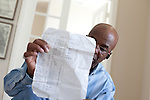 DNA Exonerated prisoner Thomas McGowan, in his home in Garland, Texas, holds a list of items he bought while in prison.