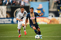 Daniel Cruz (44) of the Philadelphia Union is marked by Todd Dunivant (2) of the Los Angeles Galaxy. The Los Angeles Galaxy defeated the Philadelphia Union 4-1 during a Major League Soccer (MLS) match at PPL Park in Chester, PA, on May 15, 2013.