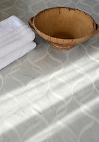 Sophie, a natural stone waterjet mosaic shown in honed Thassos and Carrara, is part of the Silk Road Collection by Sara Baldwin for New Ravenna Mosaics. <br />