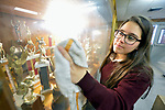 A student cleans a glass cabinet in the Lydia Paterson Institute in El Paso, Texas. Most of the school's students travel across the border every day from their homes in Juarez, Mexico, to study at the United Methodist-sponsored high school. Many repay part of their scholarships by spending two hours a day cleaning the school.