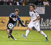 CARSON, CA – August 20, 2011: San Jose Earthquake Bobby Convey (11) and LA Galaxy defender Todd Dunivant (2) during the match between LA Galaxy and San Jose Earthquakes at the Home Depot Center in Carson, California. Final score LA Galaxy 2, San Jose Earthquakes 0.