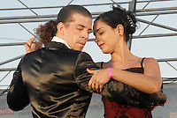 Tango Instructors Lucas Molina Gazc&oacute;n and Cecilia Piccinni (right) dance on stage with Milongatron at the Santa Monica Pier during the 27th annual Twilight Dance Series on Thursday, August 25, 2011.