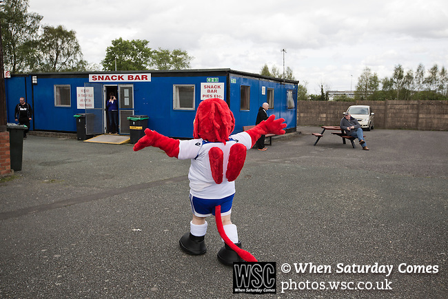 Vauxhall Motors FC 0 Solihull Moors 2, 26/04/2014. Rivacre Park, Conference North. The home team's mascot inside the ground before Vauxhall Motors play Solihull Moors at Rivacre Park in the final Conference North fixture of the season. It was to be the last match for the Ellesmere Port-based home club, named after the giant car factory in the town, who have resigned from the professional pyramid system to return to local amateur football due to spiralling costs and low attendances. Their final match resulted in a 2-0 home defeat, watched by a crowd of only 215. Photo by Colin McPherson.