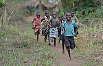 Children run along a path in Pisak, South Sudan, where the ACT Alliance is helping families produce more nutritious food.
