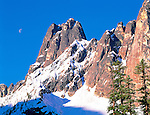 Liberty Bell peak and rising moon at sunrise in North Cascade Mts of Washington State USA