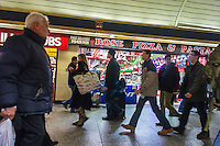 Crowds of commuters leave work to rush home through Penn Station in New York on Monday, December 31, 2012, the afternoon of New Year's Eve. (© Richard B. Levine)