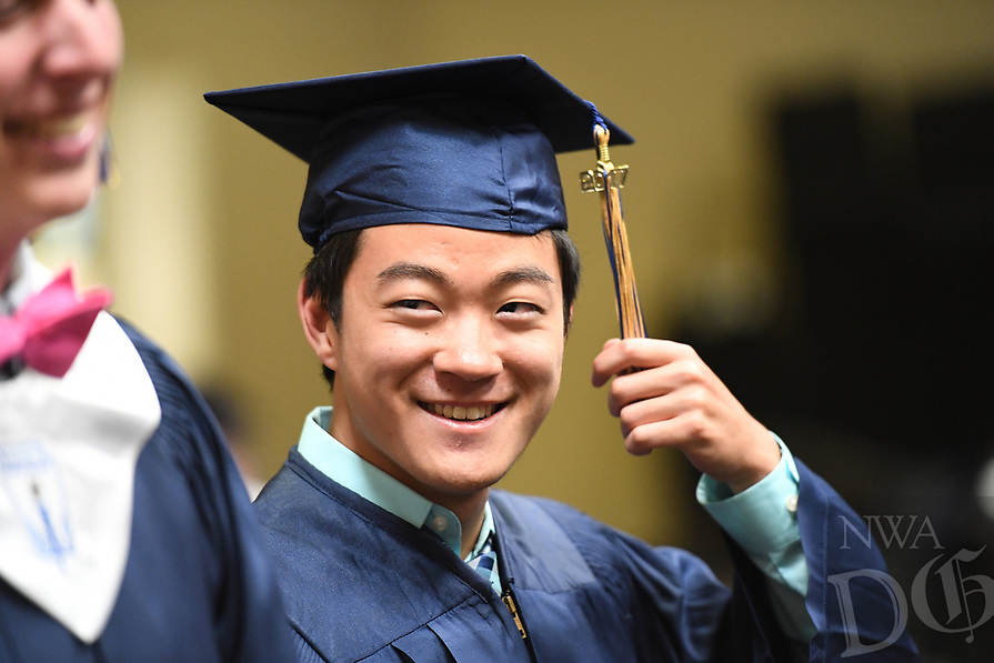 NWA Democrat-Gazette/J.T. WAMPLER Logan Pankhurst of Rogers laughs with friends Thursday May 18, 2017 before commencement ceremonies for Shiloh Christian School in Springda