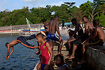 PEMBA, TANZANIA - DECEMBER 6 : Boys swim from the pier in the harbor on December 6, 2010 on Pemba, Tanzania. (Photo by: Per-Anders Pettersson)