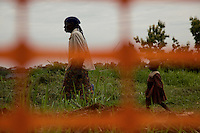 A grandmother and her grand daughter walking through Nyori refugee camp, South Sudan.