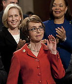 United States Representative Gabrielle Giffords (Democrat of Arizona) arrives as members of Congress applaud before US President Barack Obama's State of the Union address in front of a joint session of Congress on Tuesday, January 24, 2012 at the US Capitol in Washington, DC. .Credit: Saul Loeb / Pool via CNP