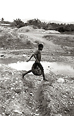 A  child plays in the river in Port-au-Prince, Haiti. photo by jane therese