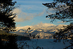Snowcovered Coeur D Alene mountains in the Kaniksu National Forest of North Idaho. Lit by the evening sun and viewed across Lake Pend Oreille from Farragut State Park.