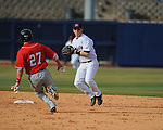 Ole Miss' Kevin Mort forces out  Arkansas State's Taylor Clements (27) at Oxford-University Stadium in Oxford, Miss. on Tuesday, February 23, 2010. Ole Miss won 3-2.