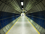 Modern Underground tunnel with lone figure walking across in distance