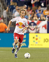 New York Red Bulls defender Stephen Keel (22) brings the ball forward. In a Major League Soccer (MLS) match, New England Revolution defeated New York Red Bulls, 2-0, at Gillette Stadium on July 8, 2012.