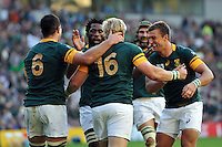Adriaan Strauss of South Africa is congratulated by his team-mates after scoring a try. Rugby World Cup Pool B match between South Africa and Japan on September 19, 2015 at the Brighton Community Stadium in Brighton, England. Photo by: Patrick Khachfe / Onside Images