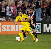 Nick DeLeon (18) of D.C. United fights for the ball with Josh Williams (3) of the Columbus Crew during the game at RFK Stadium in Washington, DC.  D.C. United defeated the Columbus Crew, 3-2.
