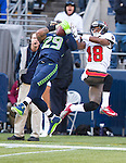 Seattle Seahawks free safety Earl Thomas (29) tries for an interception of a pass intended for Tampa Bay Buccaneers wide receiver Skye Dawson (18)in the third quarter at CenturyLink Field in Seattle, Washington on  November 3, 2013.  The Seahawks beat the Buccaneers 27-24 in overtime.  ©2013. Jim Bryant. All Rights Reserved.