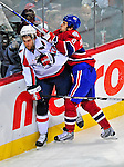 13 December 2008: Washington Capitals' defenseman Karl Alzner (27) is checked by Montreal Canadiens right wing forward Tom Kostopoulos (6) in the first period at the Bell Centre in Montreal, Quebec, Canada. ***** Editorial Sales Only ***** Mandatory Photo Credit: Ed Wolfstein Photo