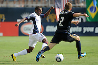 Sainey Nyassi (17) of the New England Revolution is marked by Jordan Harvey (2) of the Philadelphia Union. The Philadelphia Union and the New England Revolution  played to a 1-1 tie during a Major League Soccer (MLS) match at PPL Park in Chester, PA, on July 31, 2010.
