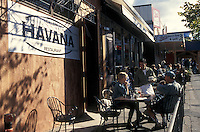 People sitting outside Havana restaurant on Commercial Drive in Vancouver, British Columbia, Canada