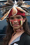 Portrait teenager Native American with face paint at Thunderbird Pow-Wow in Queens County Farm, New York.<br /> <br /> His regalia is an example of ethnic pride, heritage and a celebration of Native Americans.