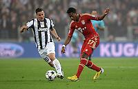FUSSBALL  CHAMPIONS LEAGUE  VIERTELFINALE  RUECKSPIEL  2012/2013      Juventus Turin - FC Bayern Muenchen        10.04.2013 Simone Padoin (li, Juventus Turin) gegen David Alaba (re, FC Bayern Muenchen)