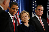 Chicago, IL - December 1, 2008 -- United States President-elect Barack Obama, left, United States Senator Hillary Rodham Clinton (Democrat of New York), middle, as his nominee for Secretary of State, and James L. Jones, right, chosen as national security adviser get ready to listen to defense secretary Robert Gates, left, who Obama says will remain in his post Monday morning, December 1, 2008 at the Chicago Hilton & Towers in Chicago, Illinois..Credit: Anne Ryan - Pool via CNP