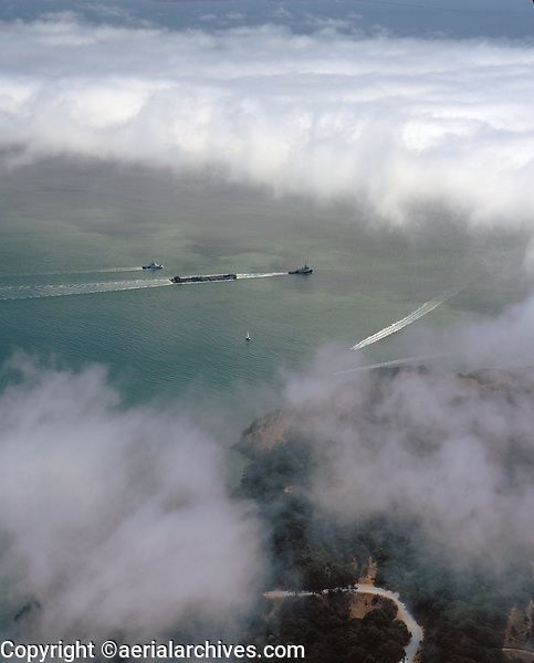 aerial photograph of tug boat pulling barge fog San Francisco Bay