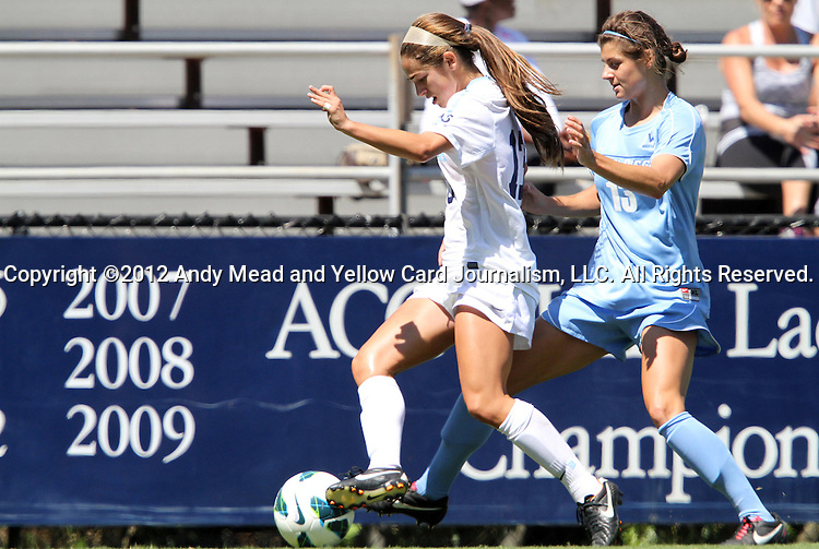 09 September 2012: UNC's Reilly Parker (left) and San Diego's Taylor Housley (right). The University of North Carolina Tar Heels defeated the University of San Diego Toreros 5-0 at Koskinen Stadium in Durham, North Carolina in a 2012 NCAA Division I Women's Soccer game.