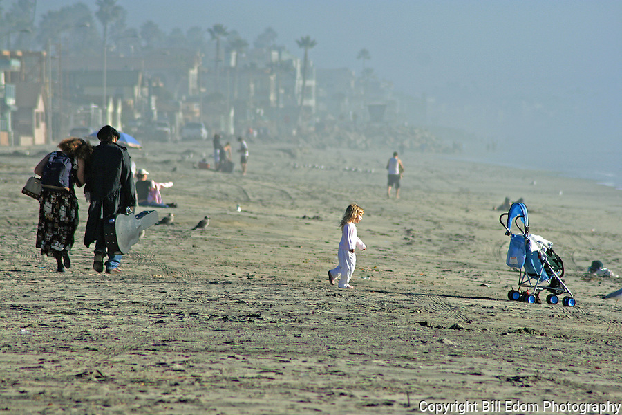 Lovers walk together on the Beach in Oceanside, California.