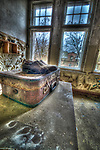 Derelict asylum interior with suitcase and shoes