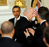United States President Barack Obama passes U.S. Vice President Joe Biden on his way to the podium to deliver remarks to the National Governors Association during a meeting in the White House State Dining Room, on Monday, February 27, 2012, in Washington, DC.  .Credit: Leslie E. Kossoff / Pool via CNP