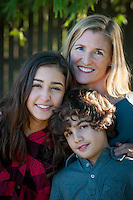 Alex Arboleda and her two children, Isabel, 13, and Nico (Nicolas), 10, enjoy each others' company at their Phoenix Home.
