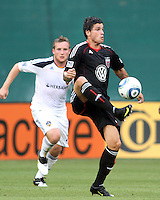 Santino Quaranta #25 of D.C. United pulls in a high ball in front of Chris Birchall #11 of the Los Angeles Galaxy during an MLS match at RFK Stadium on July 18 2010, in Washington D.C. Galaxy won 2-1.