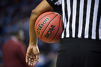 BROOKLYN, NY - Saturday December 19, 2015: A referee holds the Wilson NCAA Official Game Basketball as North Carolina takes on UCLA in the CBS Classic at Barclays Center in Brooklyn, New York.