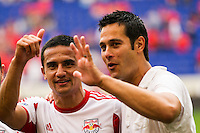 Tim Cahill (17) and head coach Mike Petke of the New York Red Bulls celebrate after the match. The New York Red Bulls defeated the Houston Dynamo 2-0 during a Major League Soccer (MLS) match at Red Bull Arena in Harrison, NJ, on June 30, 2013.
