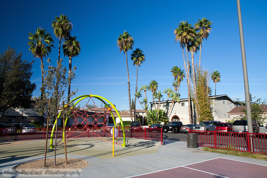 A climbing rope net play structure at Circle Park, a pocket park located on Park Circle Drive in Anaheim, California.