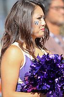 2013-09-21: Washington cheerleader Macy Sakai entertained fans during the game  against Idaho State.  Washington won 56-0 over Idaho State in Seattle, WA.